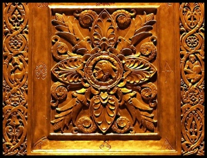 This is a small part of the detailed carvings in the bronze doors of the Plummer Building - taken at night.